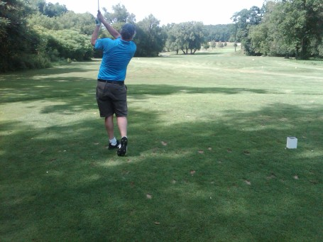 Charlie drives the front nine